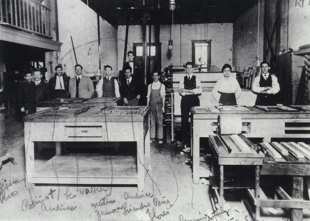Jovita Idar, second from right, stands in the print shop of Laredo's El Progreso with other newspaper employees.