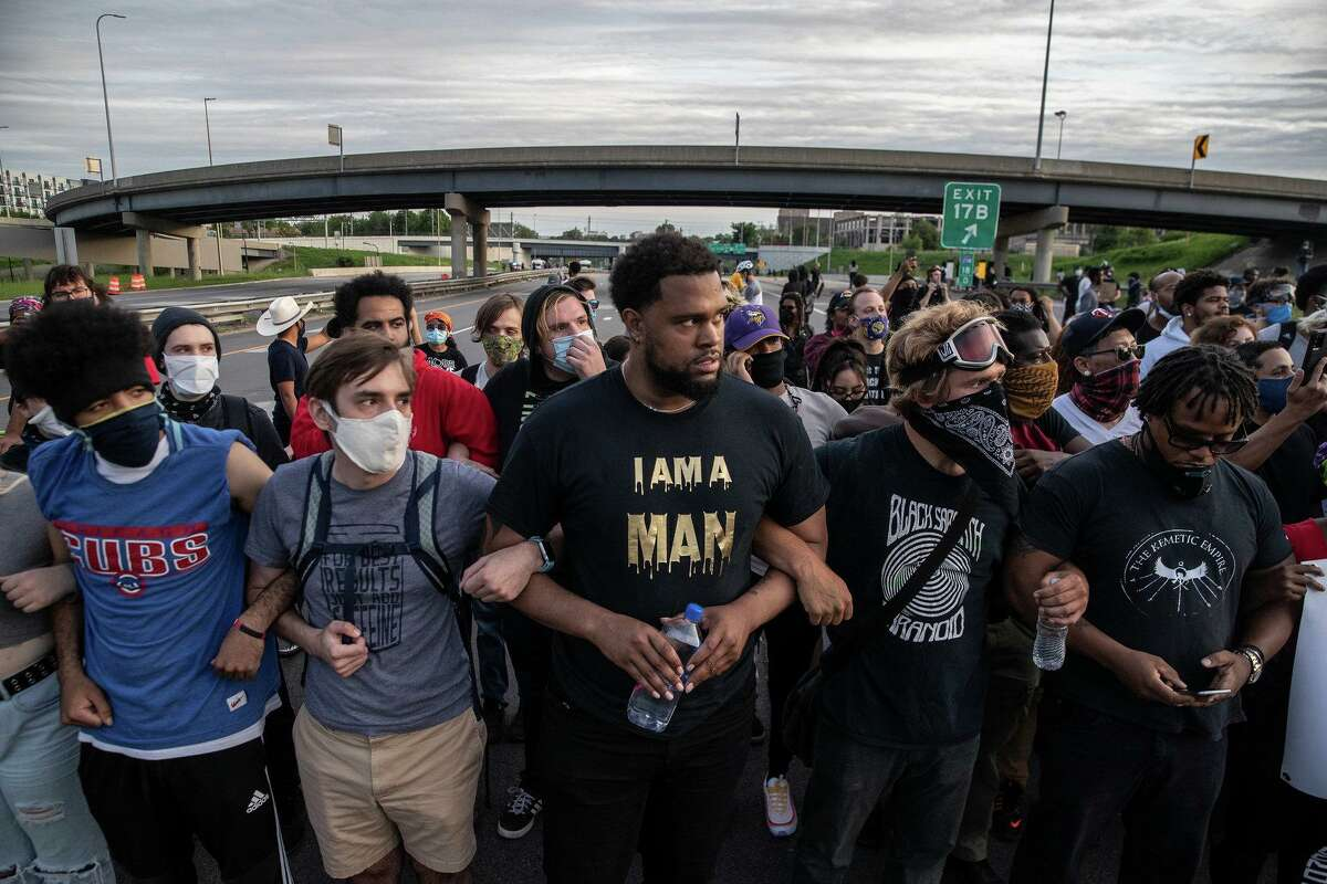 Deondre Moore joins Black Lives Matter protesters marching on Highway I-35 in Minneapolis.