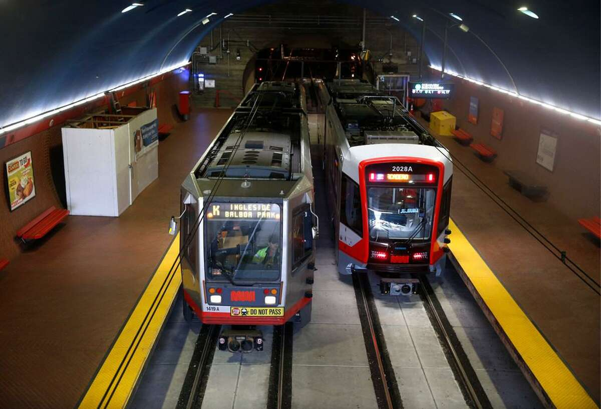 Inbound and outbound Muni Metro light rail trains stop at the West Portal station in San Francisco, Calif. on Saturday, Aug. 25, 2018. The SFMTA reopened the Twin Peaks tunnel to light rail service Saturday following a two-month closure for an extensive restoration project.