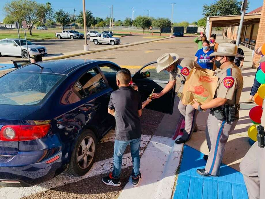 """The Texas Department of Public Safety held their Eighth Annual """"Champions of Education"""" Turkey Giveaway at Juarez-Lincoln and Kennedy-Zapata elementary schools. Troopers recognized the schools' top academic students at each grade level. Photo: Courtesy Photo /Texas Department Of Public Safety"""