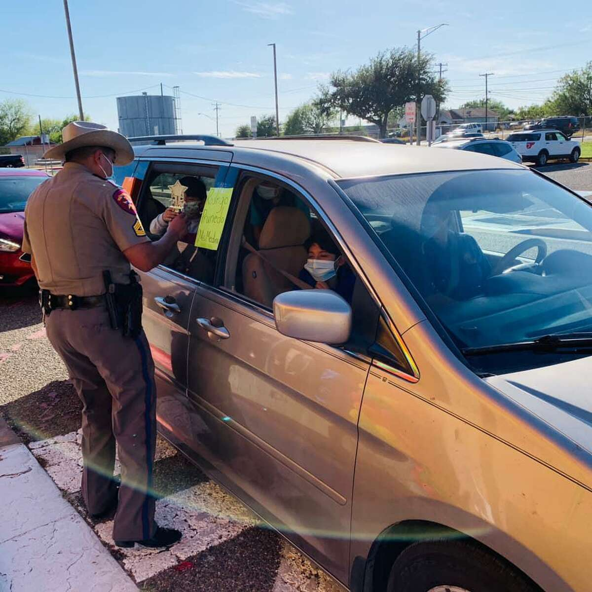 """The Texas Department of Public Safety held their Eighth Annual """"Champions of Education"""" Turkey Giveaway at Juarez-Lincoln and Kennedy-Zapata elementary schools. Troopers recognized the schools' top academic students at each grade level."""