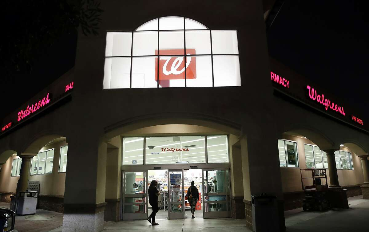 In this June 24, 2019 file photo, shoppers enter a Walgreens store in Los Angeles.