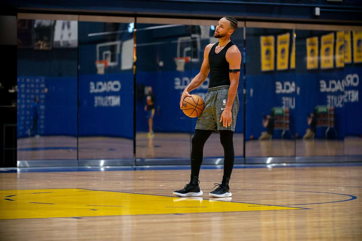 Warriors guard Stephen Curry practices on the first day of training camp at Chase Center on Wednesday. The team is scheduled to begin full-team workouts Monday.