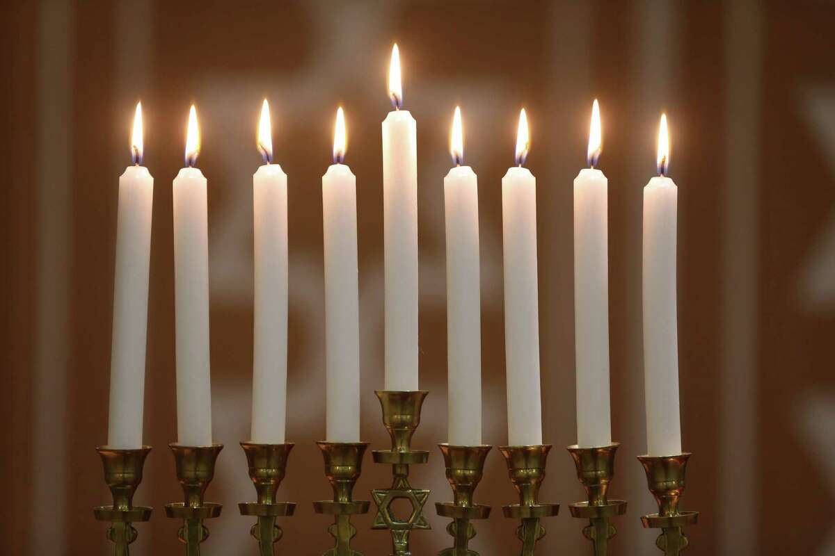 Hanukkiah with nine lit candles.