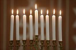 Hanukkiah with nine lit candles.
