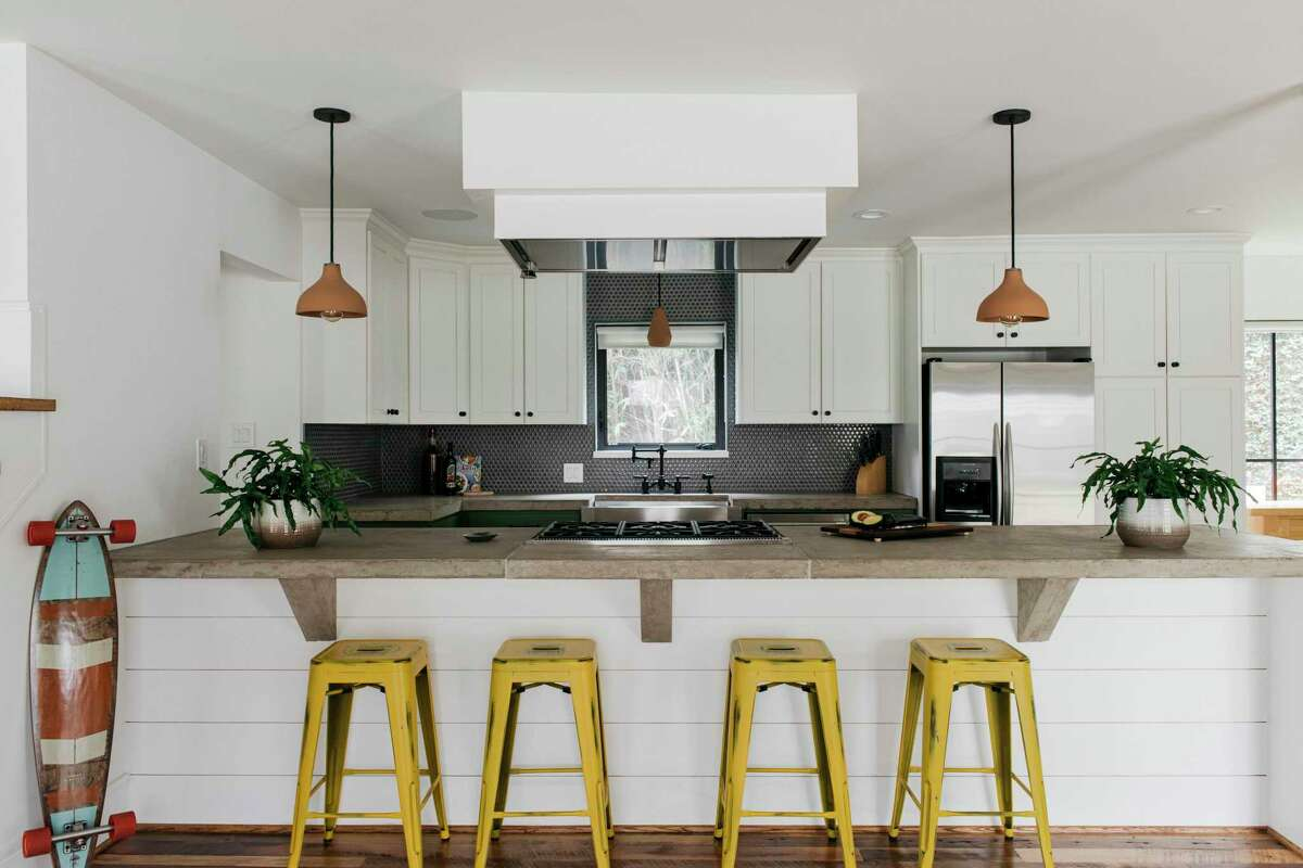 The kitchen features poured-concrete counters.