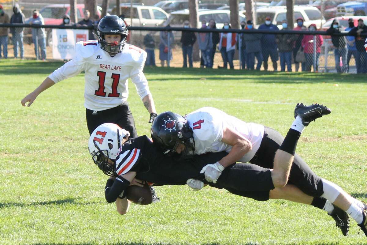 Bear Lake's Jack Cook tackles a Mesick player during a game on Oct. 10.