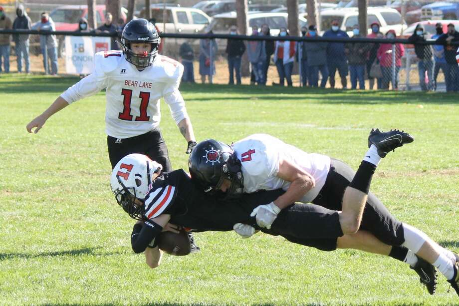 Bear Lake's Jack Cook tackles a Mesick player during a game on Oct. 10. Photo: Robert Myers