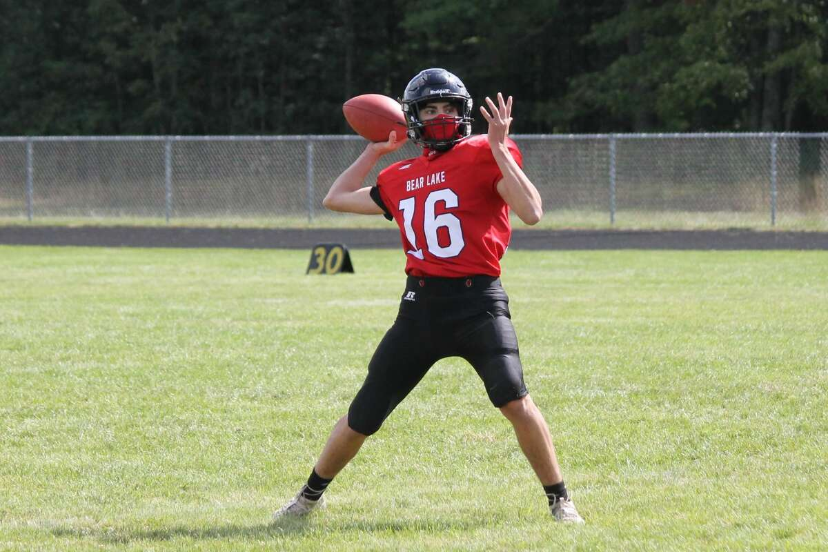 Bryce Harless, named all-region as a kicker, drops back to pass in Bear Lake's season opener against Ashley.