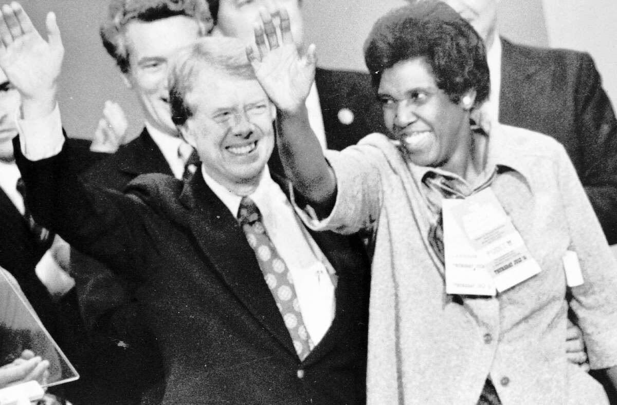 Representative Barbara Jordan, D-Texas, joins Democratic persidential nominee Jimmy Carter at the podium after Carter's acceptance speech at the Democratic National Convention in New York City in1976. Jordan's convention speech was so remarkable, it quickly spawned rumors she might be the vice presidential nominee. Jordan, whose ringing voice and unshakable faith in the Constitution inspired the nation during the Watergate impeachment hearings, died Jan. 17, 1996. She was 59.