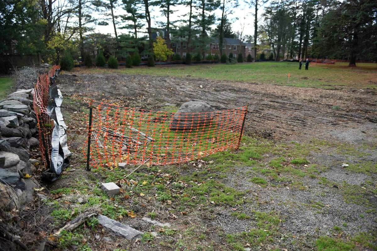 Fenced off is the site of the proposed Neighbor to Neighbor building behind Christ Church in Greenwich, Conn. Wednesday, Nov. 18, 2020. The community food bank, which also gives out clothing, is located at Christ Church and will get a new standalone facility built there after years of work to get approvals.