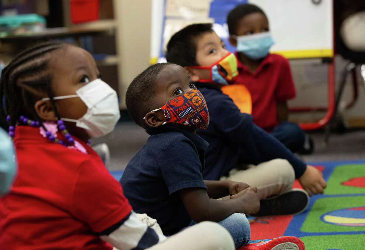 Best Elementary School pre-kindergarten students observe their teacher practice the sound of letters with them during class, Thursday, Dec. 3, 2020, in Houston.