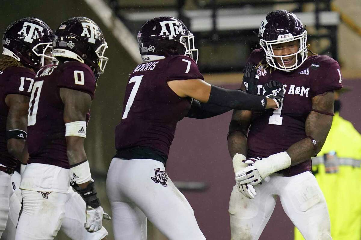 Texas A&M linebacker Buddy Johnson (1) celebrates with teammates after he intercepted an LSU pass and returned it for a touchdown during the third quarter on Nov. 28, 2020, in College Station.