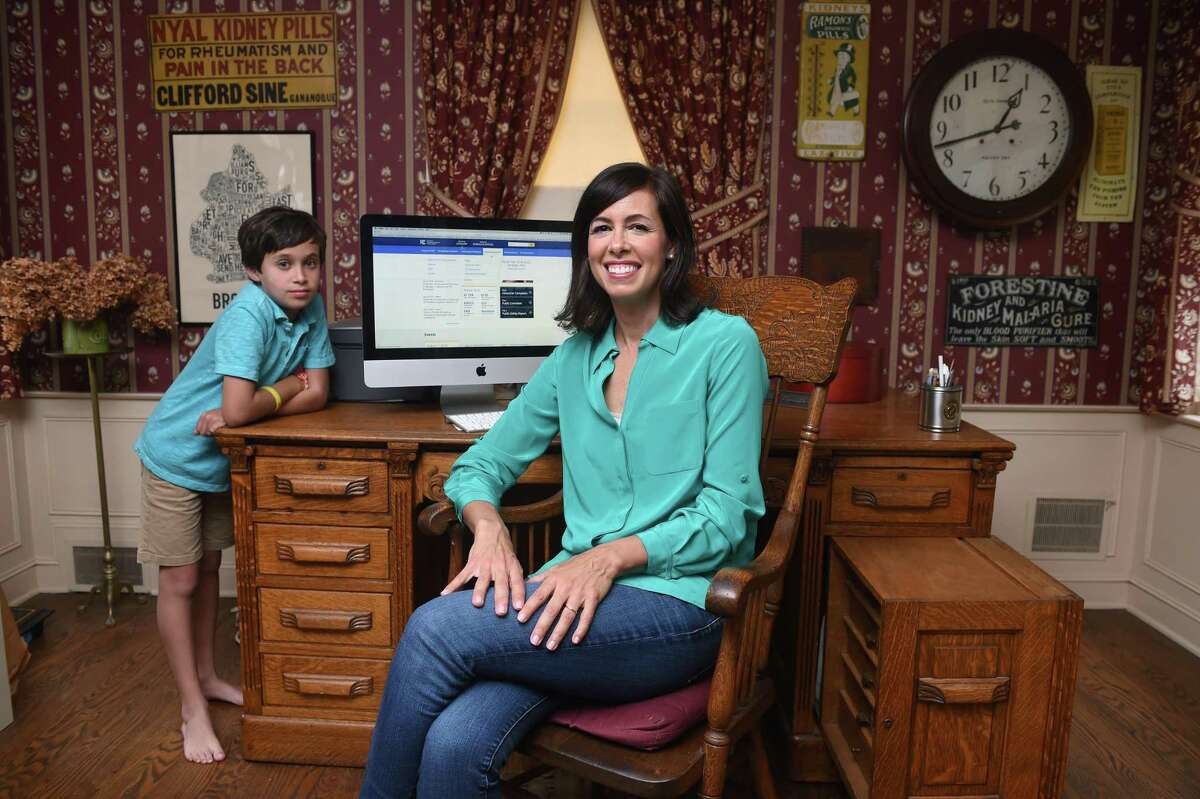 FCC Commissioner Jessica Rosenworcel alongside son Emmett, in July 2019 at her childhood home in West Hartford. Rosenworcel has been an advocate of standardizing 5G architectures to ensure interoperability and accelerate the roll-out of the technology.