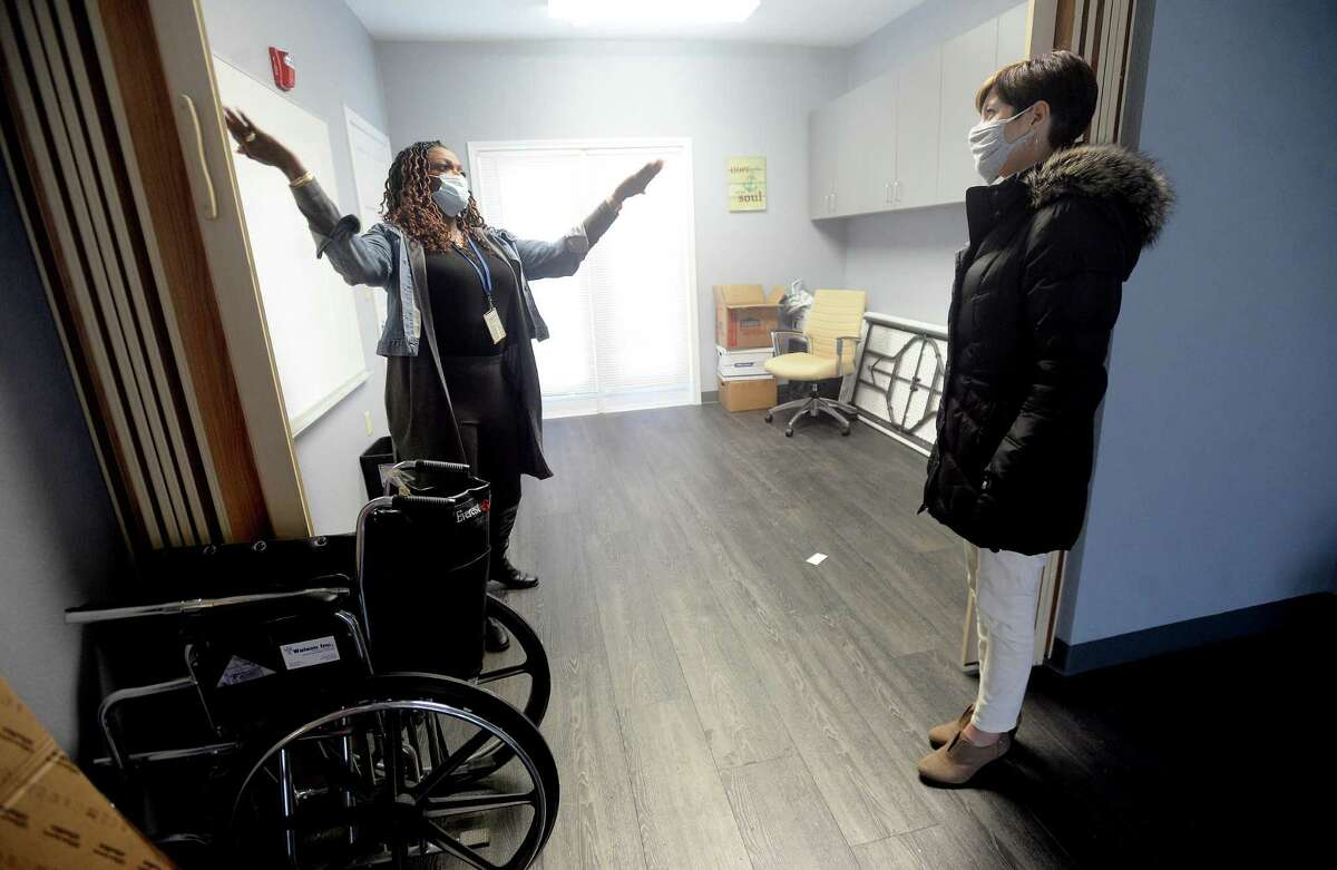Tina Simpson (left) talks about all the renovations and updates made as she gives the Spindletop Center's Heather Champion a tour at The Hope Center, which reopened Monday after remaining closed and under repair since flooding during Tropical Depression Imelda. Photo taken Tuesday, December 1, 2020 Kim Brent/The Enterprise