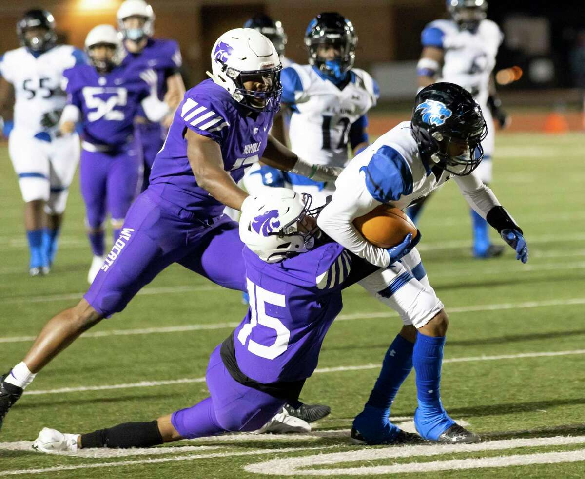 C.E. King wide receiver Eric Adams (3) is grabbed by Humble defensive back Avory Coleman (15) during the second quarter of a District 21-6A football game at Turner Stadium, Thursday, Dec. 3, 2020.