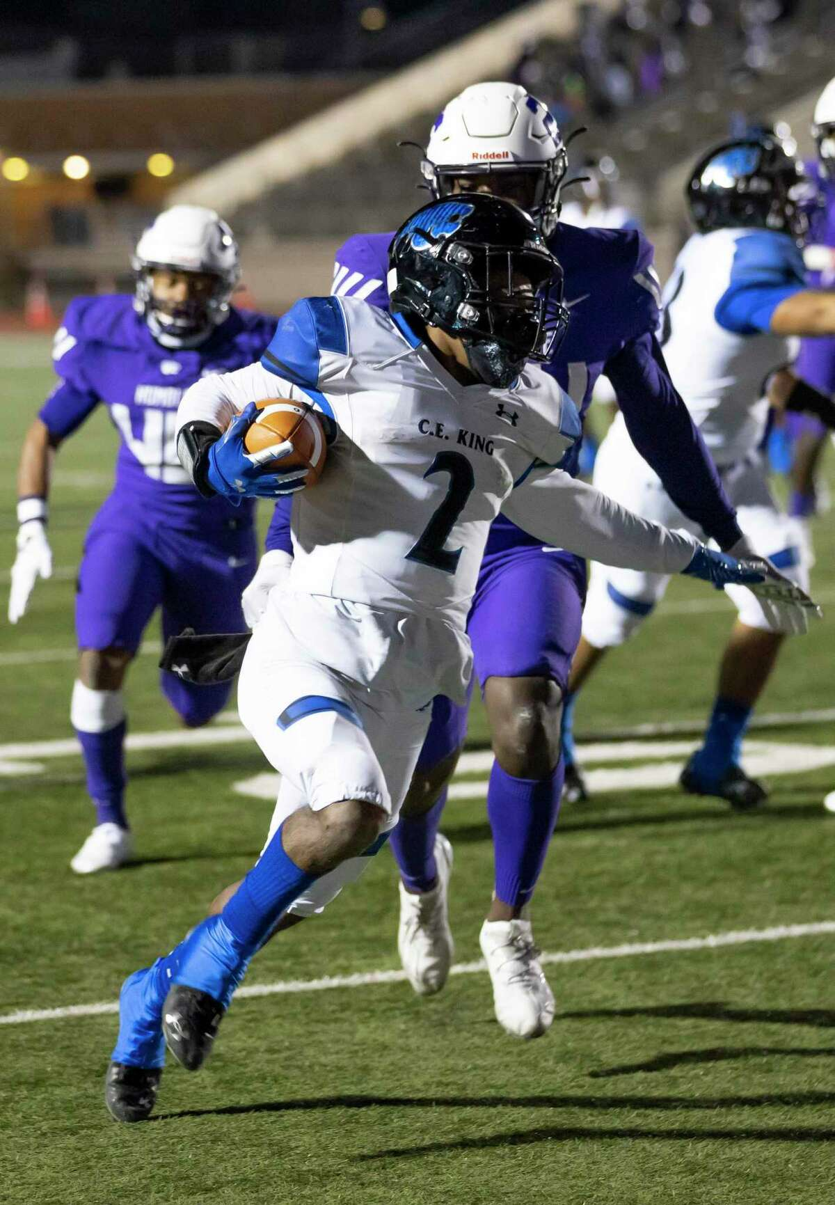 C.E. King Kodi Russi (2) scores a touchdown despite pressure from Humble defensive back Jatavian James (24) during the fourth quarter of a District 21-6A football game at Turner Stadium, Thursday, Dec. 3, 2020.