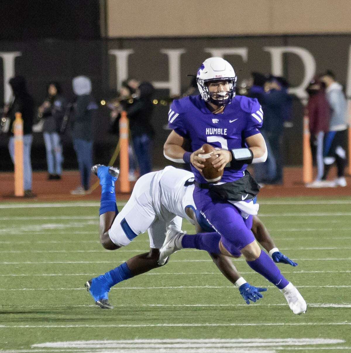 Humble quarterback Jeremiah Price Knott (2) is ran out oof bounds during the second quarter of a District 21-6A football game against C.E. King at Turner Stadium, Thursday, Dec. 3, 2020.