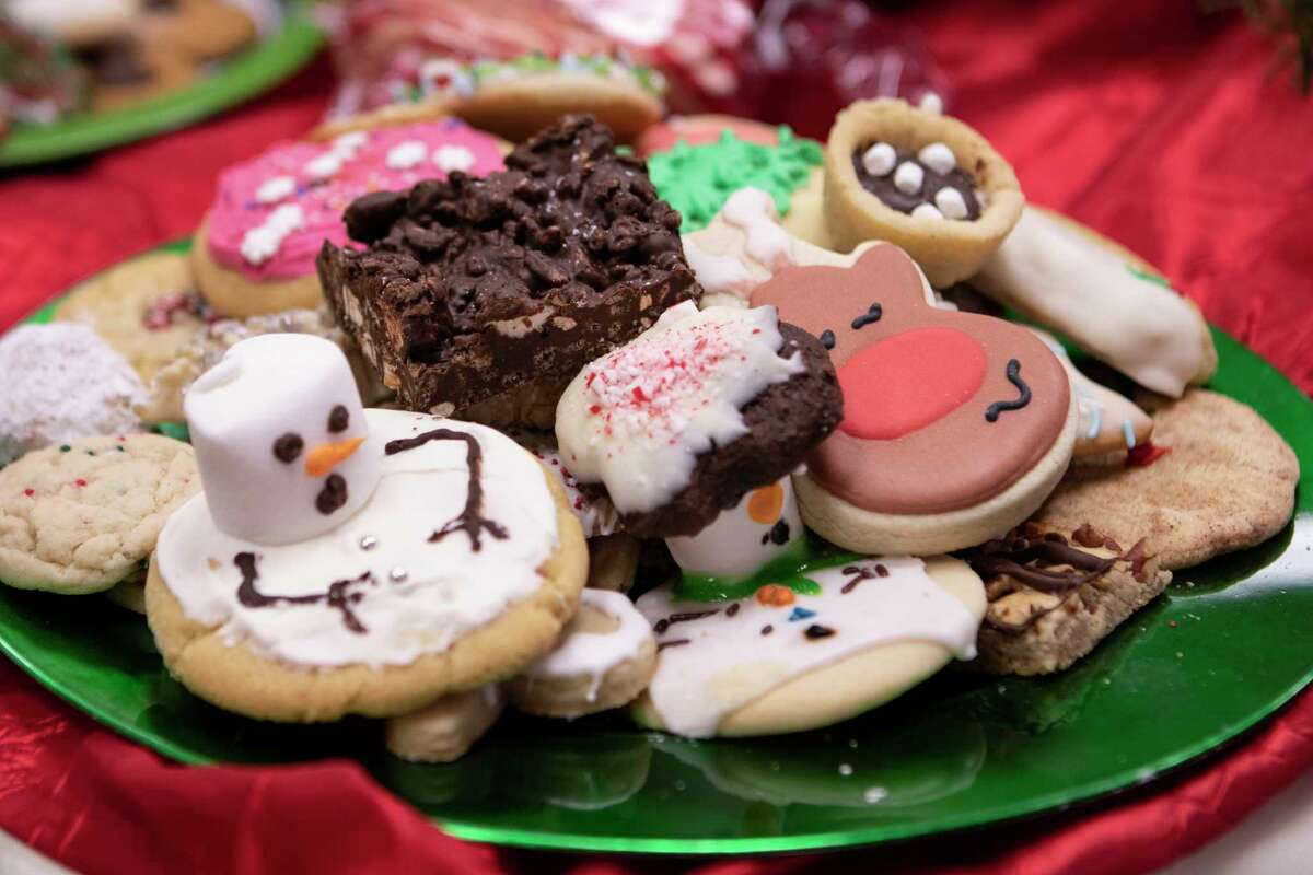 A plate of cookies awaits customers to pick them up during the Mongomery Christmas Celebration Cookie Walk on Saturday, Dec. 8, 2018 in Montgomery.