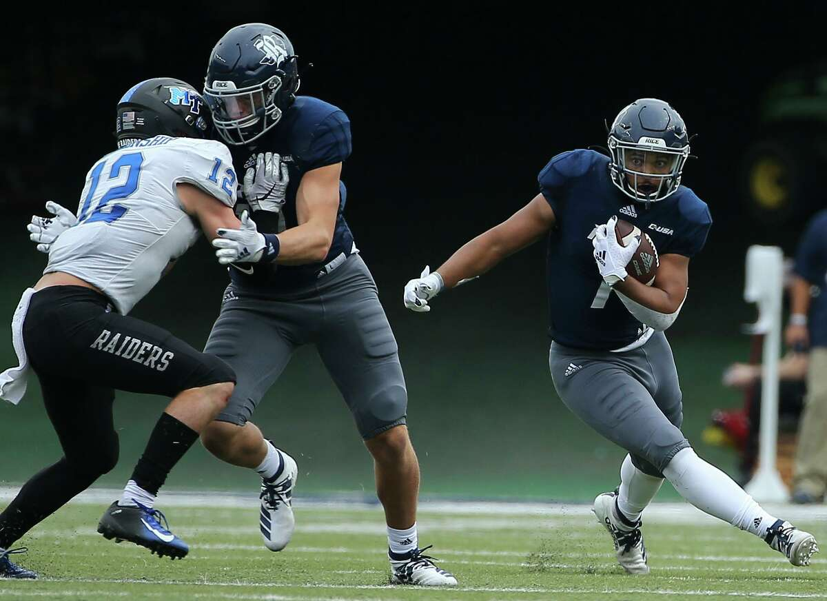 Defensive end Trey Schuman, right, and Rice have been preparing as normal every week despite having three of their last four games canceled or postponed since Oct. 31.