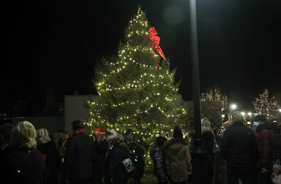 Port Austin kicked off a weekend-long celebration of the holiday season with its official Christmas tree lighting ceremony on Friday night. Photo: Mark Birdsall/Huron Daily Tribune