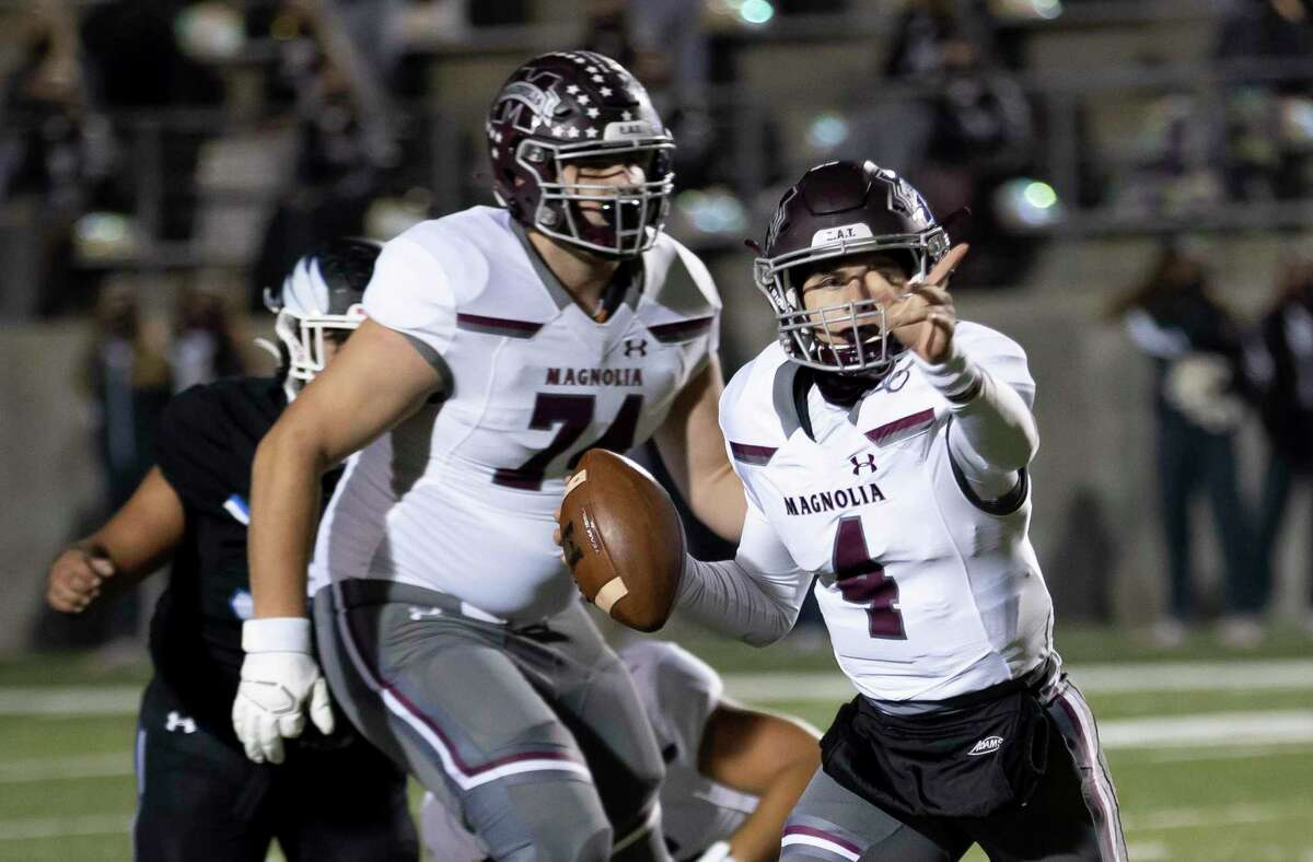 Magnolia quarterback Travis Moore (4) signals his pass during the first quarter of a District 8-5A (Div. I) football game against New Caney at Randall Reed Stadium in New Caney.