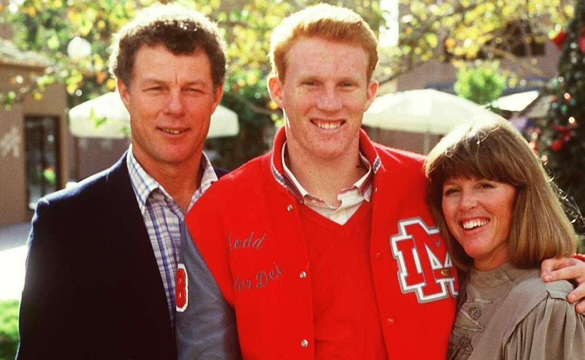 Todd Marinovich, center, with father Marv and mother Trudi in 1986 in San Juan Capistrano.