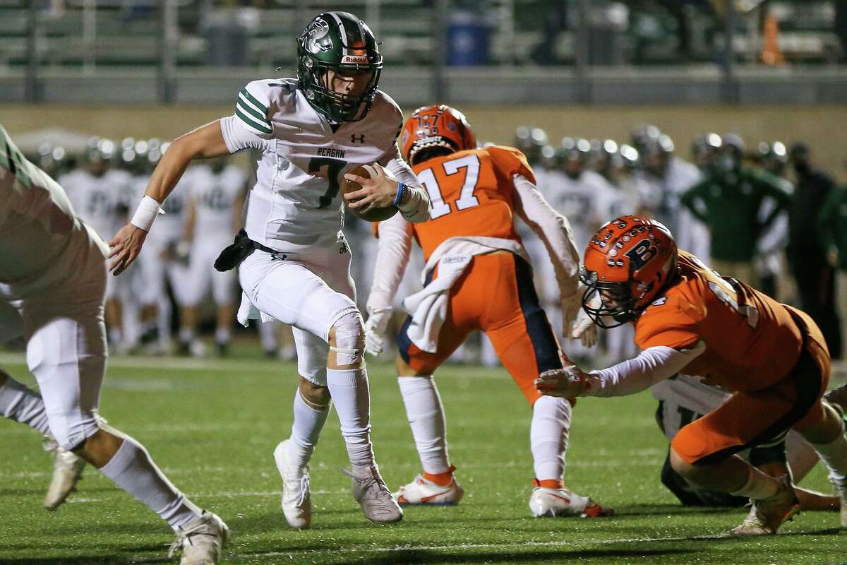 Reagan quarterback Britton Moore (7) scores on a 3-yard run during the first half against Brandeis at Farris Stadium on Friday. The win clinched the District 28-6A title for the Rattlers.