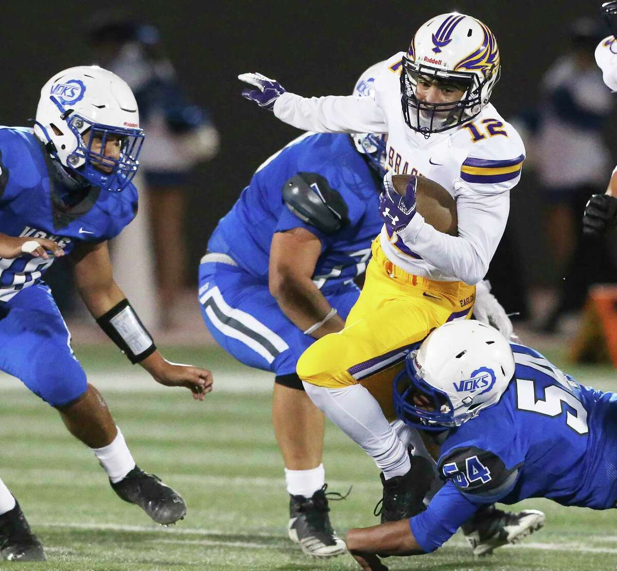 Aiden Garcia is brought on the ground by Vok defender Dontrevious Wellons as Brackenridge plays Lanier for the District 13 5-A-I championship at Alamo Stadium on Dec. 4, 2020.