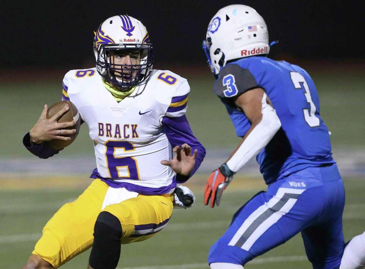 Eagles quarterback Carlos Camargo faces off with Vok defender Savian Perez as Brackenridge plays Lanier for the District 13 5-A-I championship at Alamo Stadium on Dec. 4, 2020.