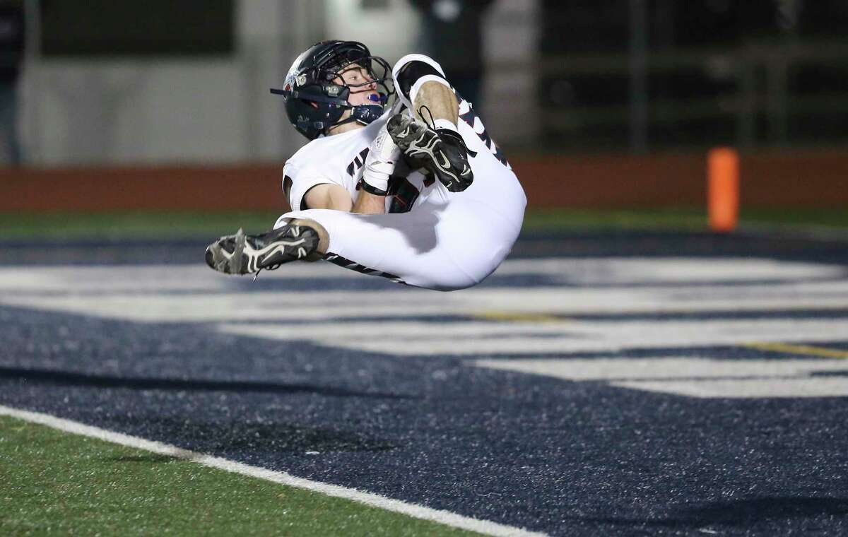 Wimberley Texans' Nova Rankin (32) flips into the end zone on a fumble recovery for a touchdown against Navarro Panthers during their Class 4A Division II state quarterfinal football game in Boerne on Friday, Dec. 4, 2020.