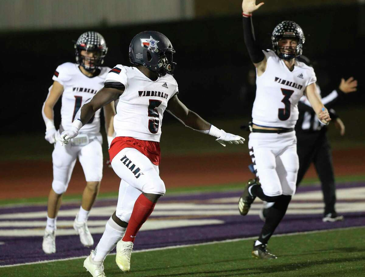 Wimberley Texans' Moses Wray (05) celebrates with teammates including quarterback Matthew Tippie (03) after his 66-yard touchdown run against Navarro Panthers during their Class 4A Division II state quarterfinal football game in Boerne on Friday, Dec. 4, 2020.