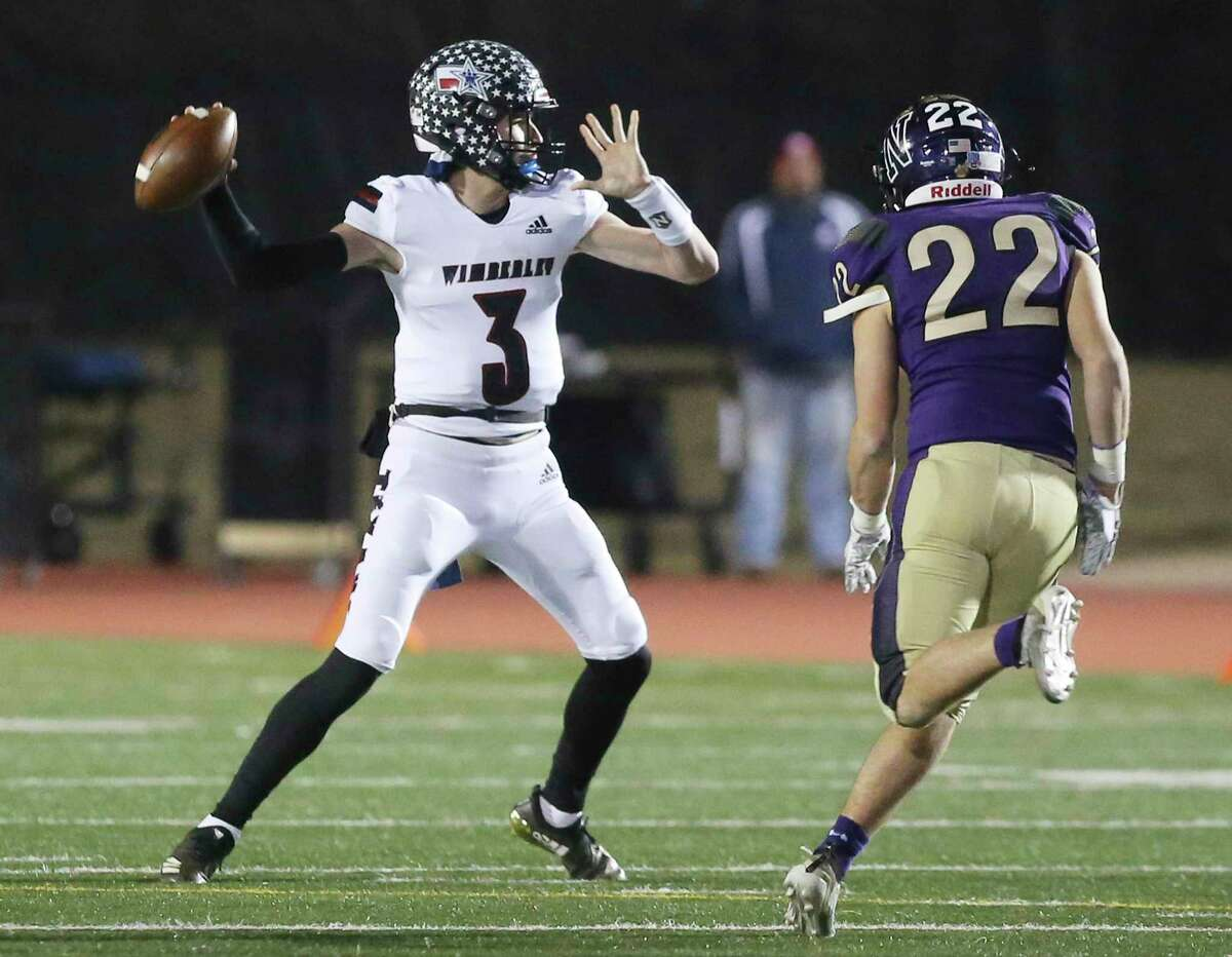 Wimberley Texans quarterback Matthew Tippie (03) looks to pass against Navarro Panthers' Case Monroe (22) during their Class 4A Division II state quarterfinal football game in Boerne on Friday, Dec. 4, 2020.