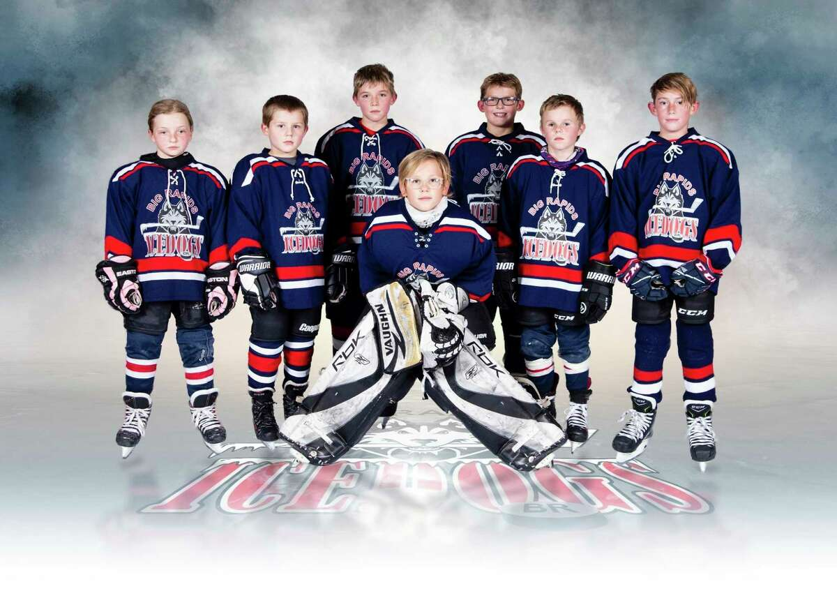 The 2020-21 Big Rapids Ice Dogs squirt hockey team coached by Neil Ososki.Players on the roster are Reid Curtis, Cade Dowell, Murphy Kwant, Easton Ososki, Brody Park, Landon Smeaton, Cash Ziska and Noelle Zocco. (Courtesy photo/Ron Repke)