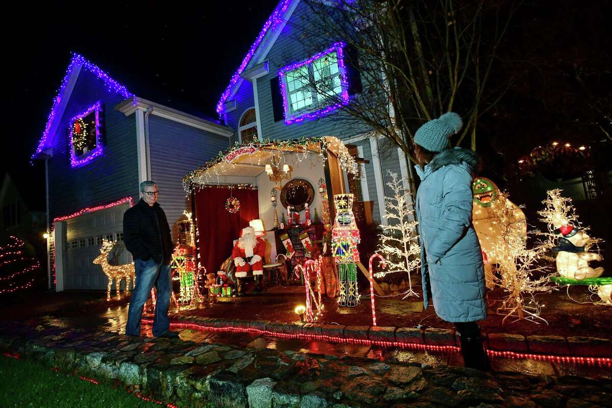 Robert and Sandy Timmons and their outdoor Christmas decorations at their home Friday, December 4, 2020, in Norwalk, Conn. The Timmons set up a fake living room/Santa scene for families to come and take holiday pictures since Santa meet-and-greets were cancelled this year. set up a fake living room/Santa scene for families to come and take holiday pictures since Santa meet-and-greets were cancelled this year. The lights come on at 5 p.m. daily.
