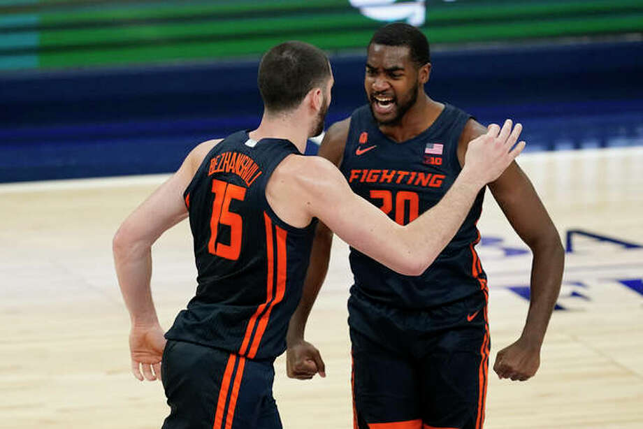 Illinois' Giorgi Bezhanishvili (15) celebrates with Da'Monte Williams (20) after Bezhanishvili hit a 3-point shot during the first half of the team's NCAA college basketball game against Baylor, Wednesday, Dec. 2, 2020, in Indianapolis. Photo: Associated Press