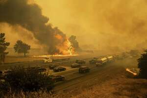 The LNU Lightning Complex fire jumps Interstate 80 in Vacaville, Calif., on Aug. 19, 2020.