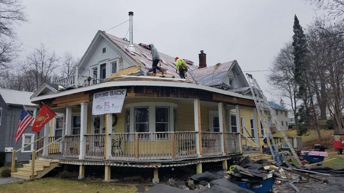 Palmer Avenue, Corinth resident Joseph Salisbury, a Marine Corps and Army Reserves veteran, received a new roof on Dec. 2 from Pinnacle Roofing Inc., an Owens Corning Platinum Roofing contractor, as part of the Owens Corning Roof Deployment Project.Through a partnership with Rebuilding Together Saratoga County, Salisbury was selected and approved as the recipient for the roof replacement.The project is a nationwide effort to show gratitude and honor the veterans and the families who support them.