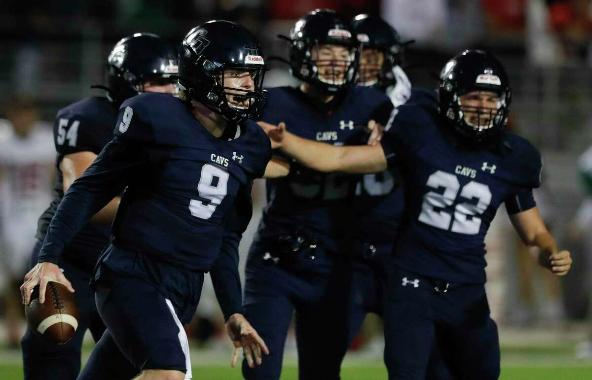 College Park quarterback Hank Hudson (9) reacts after defeating The Woodlands 35-31 to win the District 13-6A championship at Woodforest Bank Stadium, Friday, Nov. 27, 2020, in Shenandoah.