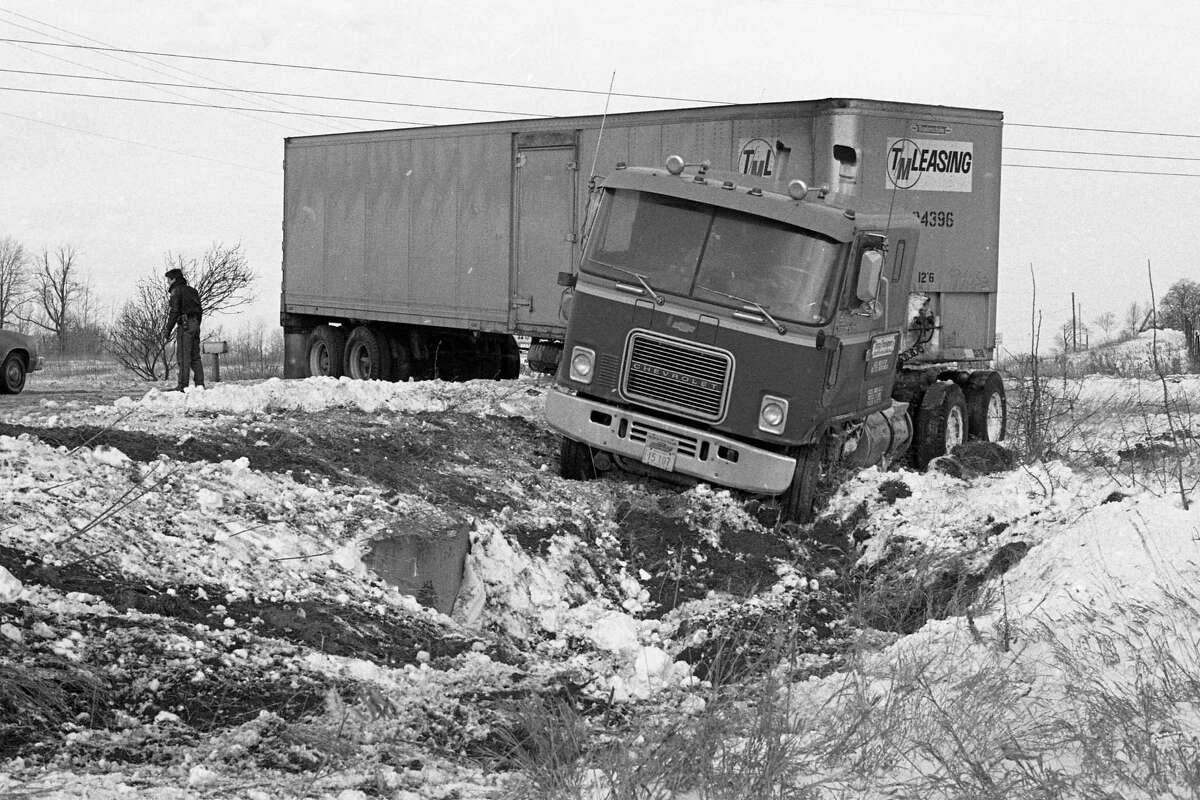 An empty semi-truck went out of control and slid off US-31 near the Mason County line in the early hours of Dec. 4, 1980. It was believed that the accident may have been caused by a gust of wind which pushed the empty trailer across the road. (Manistee County Historical Museum photo)
