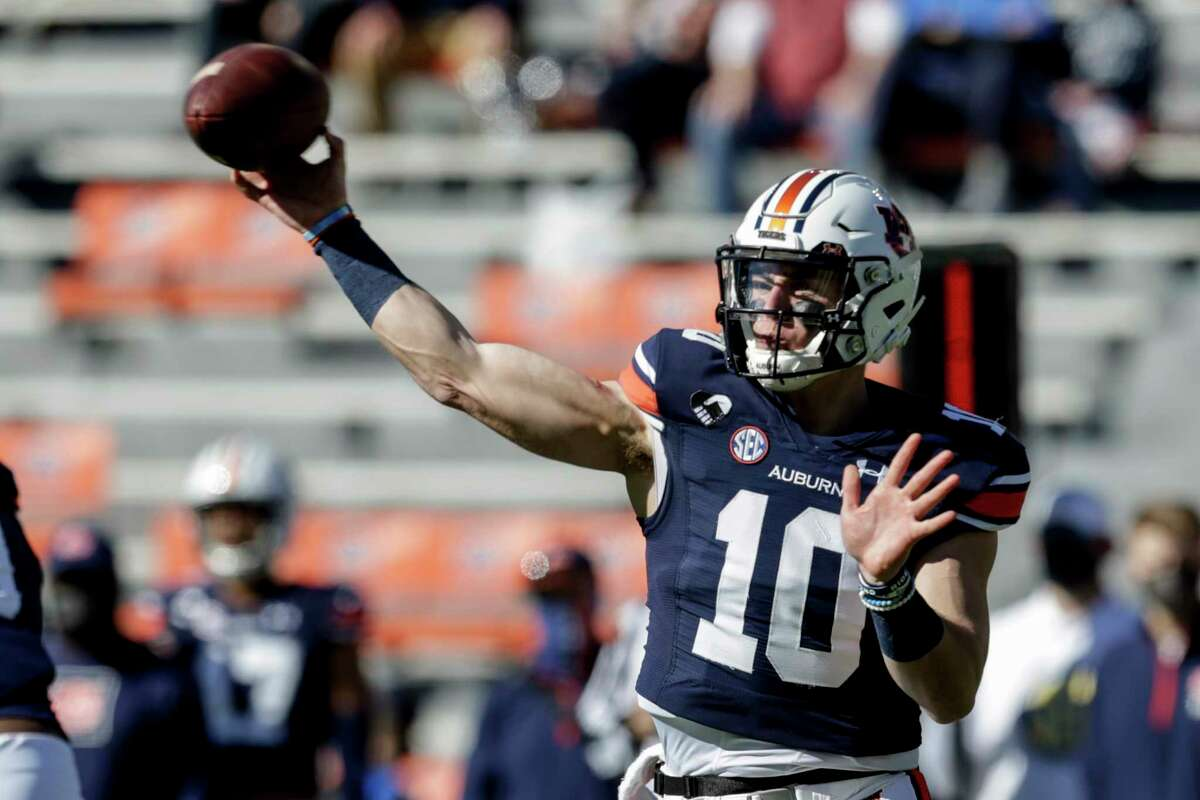 Auburn quarterback Bo Nix (10) throws a pass against Texas A&M during the first half of an NCAA college football game on Saturday, Dec. 5, 2020, in Auburn, Ala. (AP Photo/Butch Dill)