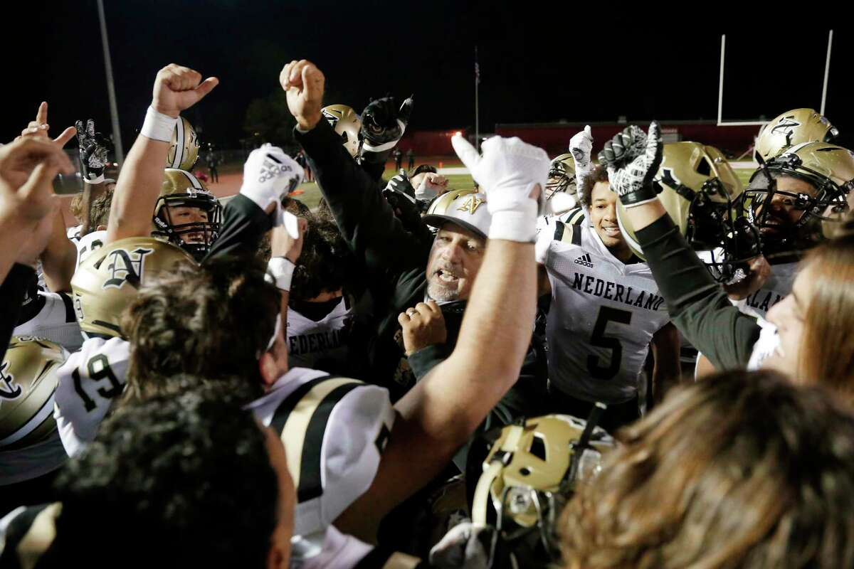 Nederland head coach Monte Barrow, center, cheers in celebration with his players after their 29-24 win against Crosby after a high school football game at Cougar Stadium Friday, Dec. 4, 2020 in Crosby, TX.