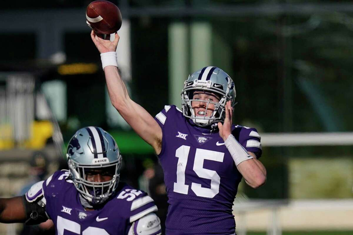 Kansas State quarterback Will Howard (15) passes to a teammate during the first half of an NCAA college football game against Texas in Manhattan, Kan., Saturday, Dec. 5, 2020. (AP Photo/Orlin Wagner)