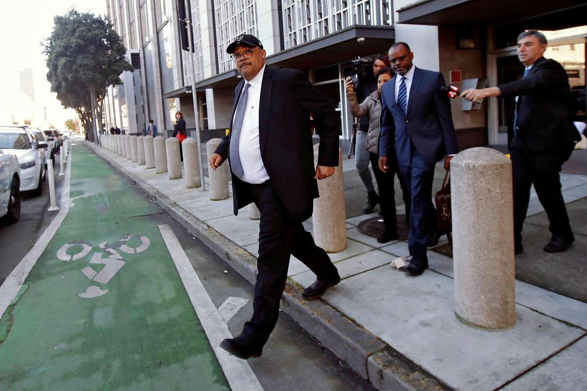 Mohammed Nuru, director of San Francisco Public Works, left, walks in front of attorney Ismail Ramsey as they leave a federal courthouse in San Francisco, Thursday, Feb. 6, 2020. (AP Photo/Jeff Chiu)