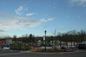 Work on the Brookfield Village project at the four corners is progressing. Steel has started to be installed and a crane will arrive next week to lift beams into place for the upper floors. Friday, December 4, 2020, in Brookfield, Conn..