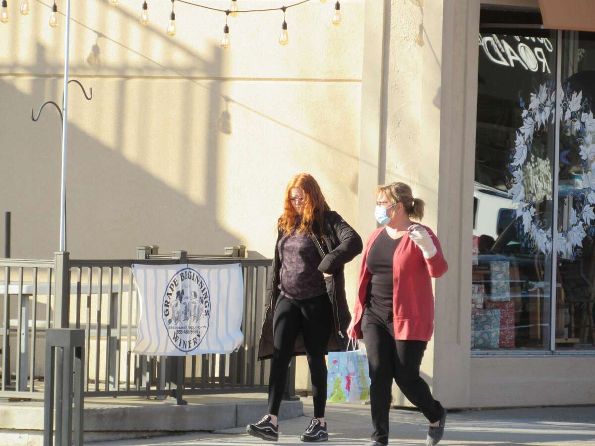 Shoppers stroll through downtown Midland on Saturday afternoon, Dec. 5. Holly Jolly Days continue 10 a.m.-5 p.m. every day through Sunday, Dec. 13.