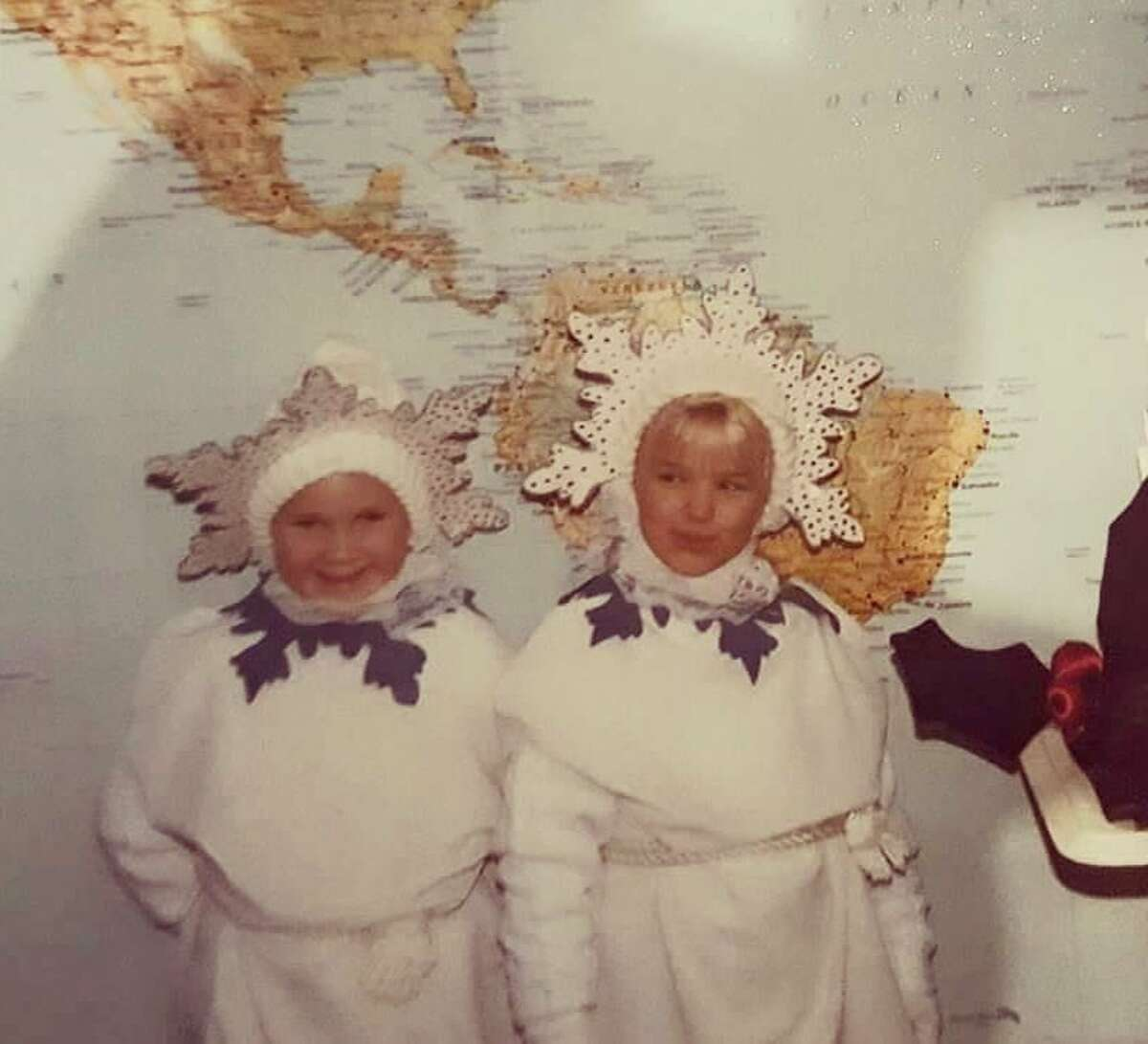 Katie Erickson (left) and Brittany Levandoski dress as snowflakes, circa 1992. (Submitted by Jan Erickson)