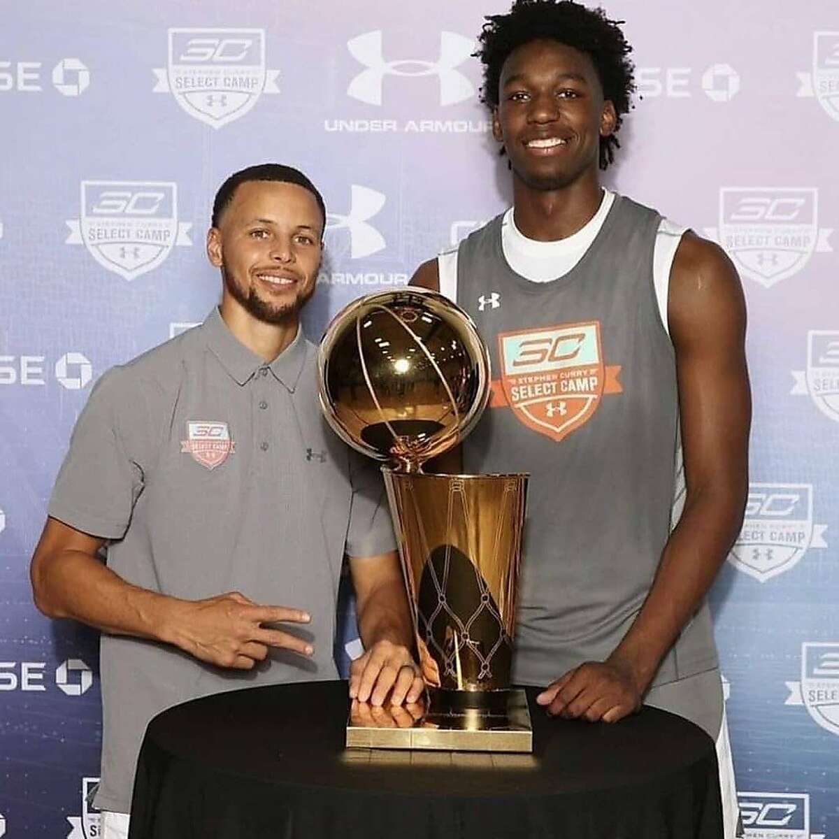 Stephen Curry poses with James Wiseman at his 2018 camp. The 7-footer is one of seven at that camp who were drafted into the NBA this year - two by the Warriors.