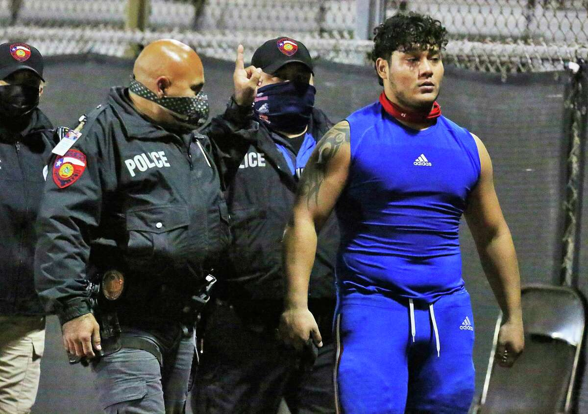 Edinburg's Emmanuel Duron, escorted out of the stadium by police after charging a referee during Thursday's game against Pharr-San Juan-Alamo, was charged with assault Friday and his team was removed from the state playoffs.