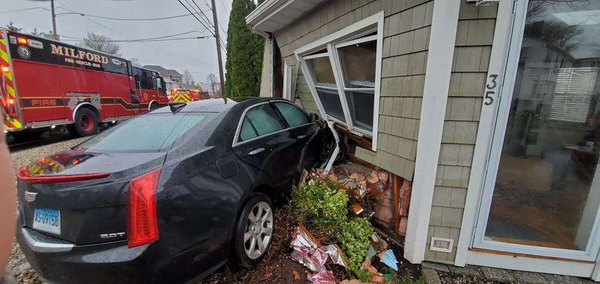 Officials responded to a house on South Street after a car smashed into it, resulting in one person getting injured and a